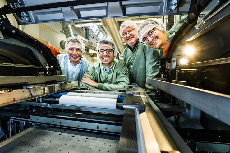 Researchers by their roll-to-roll printer
